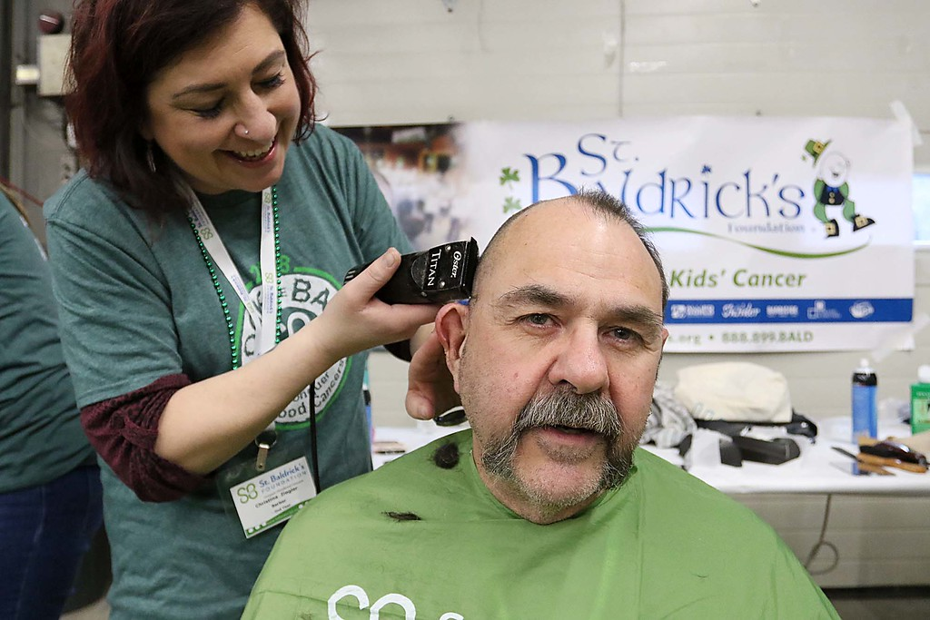 . The 16th annual St. Baldrick\'s fundraiser was held by the Pepperell Fire Department on Wednesday night, March 14, 2018. Participant Mark Limanek of Lowell gets his hair cut by Christina Ziegler of Serenity Spa & Salon out in Tyngsboro. This Ziegler\'s second year cutting hair at the event. SENTINEL & ENTERPRISE/JOHN LOVE