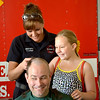 Effingham Firefighter Tasha Lange and her daughter, Kyandra, shaved the head of father, husband and Effingham Police Officer Aaron Lange at Fire Station 1 Saturday.