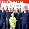Members of the Effingham Fire Department stand with cancer survivor and St. Anthony's Grade School first grader, Luke Johnson. From left back row are: Jim Wolters, Aaron Paddock, Jim Charters, Jason Lee, Howard Janis and J.R, Nieman. Front row are: Blake Poe, Chad Beag, Lucas Kroening, Jeff Landrus, Tyson Massey and Matt Brown.