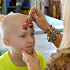 Junior Effingham Firefighter and cancer survivor, Luke Johnson, has a fire truck painted on his forehead after having his head shaven in support of St. Baldrick's Foundation, which raises money for cancer research.