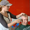 Ashley Janis shaves Major Strange's head, who participated in St. Baldrick's Foundation to raise money for cancer research.