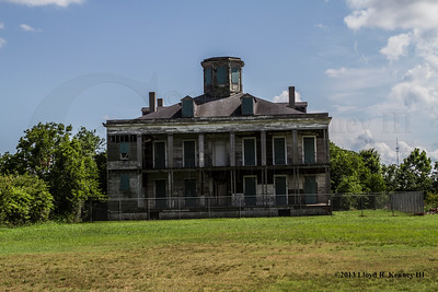 The LeBeau Mansion (LeBeau Plantation) in Arabi, Louisiana June 8th, 2013 @ 4:35:19 PM.  During the early morning hours of Friday November 22nd, 2013 seven folks from somewhere in Tx were Ghost Hunting in the LeBeau Plantation and set fire to her. This is a sad day for the residents and past residents who lived to love the Old Historic Site that they called Home.   Photography By: Lloyd R. Kenney III ©2013 All Rights Reserved. Contact info: LloydKenneyiii@gmail.com