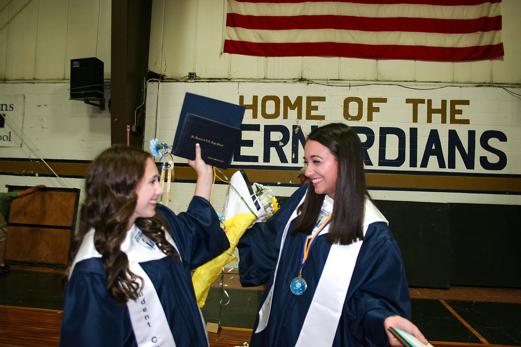 . St. Bernard\'s Central Catholic High School Class of 2018 members Sarah Bica, left, and Winona Daw celebrate after their commencement ceremony. SENTINEL & ENTERPRISE/JULIA SARCINELLI