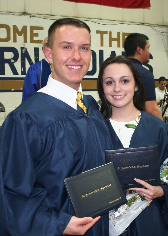 . St. Bernard\'s Central Catholic High School Class of 2018 members Sean McCue, left, and Nicole Boucher enjoy a moment after their commencement ceremony. SENTINEL & ENTERPRISE/JULIA SARCINELLI