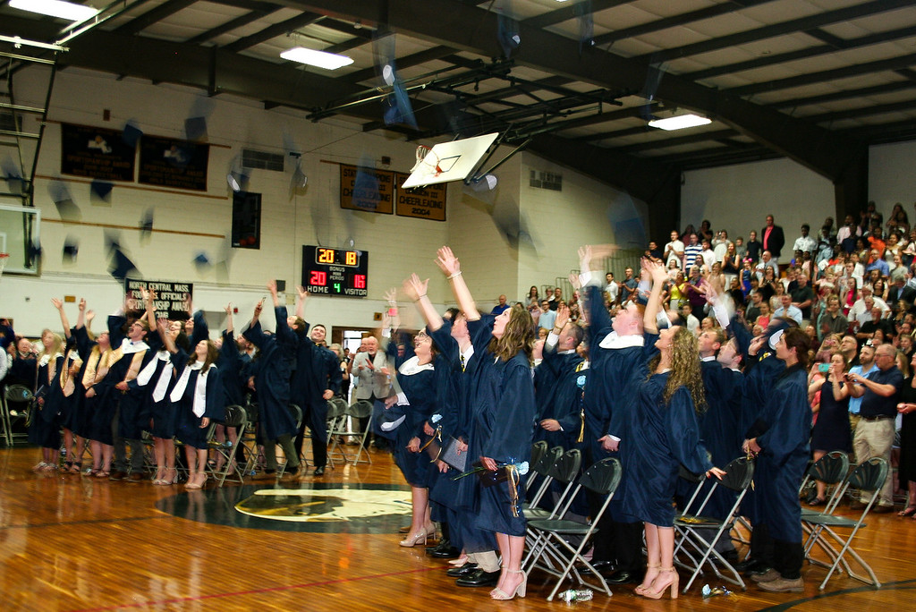. St. Bernard\'s Central Catholic High School\'s Class of 2018 celebrates matriculation by tossing their mortarboards. SENTINEL & ENTERPRISE/JULIA SARCINELLI