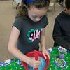 St. Bernard's Elementary School's Holiday Fair Saturday, Nov. 23, 2019. Making some slime at the fair is Anna Quinn, 9, from Fitchburg. SENTINEL & ENTERPRISE/JOHN LOVE