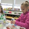 St. Bernard's Elementary School's Holiday Fair Saturday, Nov. 23, 2019. Decorating a paper gingerbread person is Sophia Krook, 7, from Lunenburg. SENTINEL & ENTERPRISE/JOHN LOVE