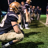 St. Bernards Jake Aubuchon squats on the side line after as he comes off the field during Friday nights game at home against Leicester High School.  Sentinel & Enterprise photo/Jeff Porter