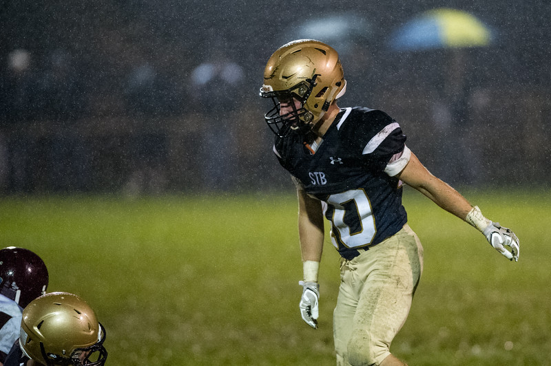 St. Bernards Riley Brown stands gets up after the play as the rain comes down during Friday nights game at home against Leicester High School.  Sentinel & Enterprise photo/Jeff Porter