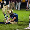 St. Bernards Jake Aubuchon sit's on the field after the ball slips out of his hands during Friday nights game at home against Leicester High School.  Sentinel & Enterprise photo/Jeff Porter