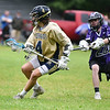 (06/04/18) Dom Valera (4) of St. Bernard's changes direction with the ball during Monday's boys varsity lacrosse game at home against Blackstone.  SENTINEL & ENTERPRISE JEFF PORTER