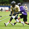 (06/04/18) Nick Bagley of St. Beranrd's (left) fights for possession with Jack Kinselk of Blackstone during Monday's boys varsity lacrosse game at home against Blackstone.  SENTINEL & ENTERPRISE JEFF PORTER