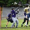 (06/04/18) Nick Bagley of St. Bernard's (5) shoots the ball and scores but the goal is reversed by the refs during Monday's boys varsity lacrosse game at home against Blackstone.  SENTINEL & ENTERPRISE JEFF PORTER