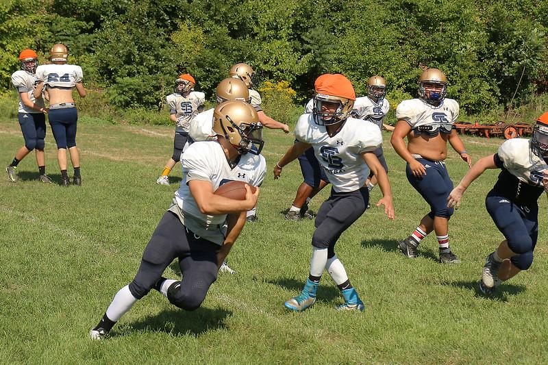 St. Bernard's High School Head fullback senior James Xarrax takes off around the outside with the ball during practice on Thursday morning.  SENTINEL & ENTERPRISE/JOHN LOVE