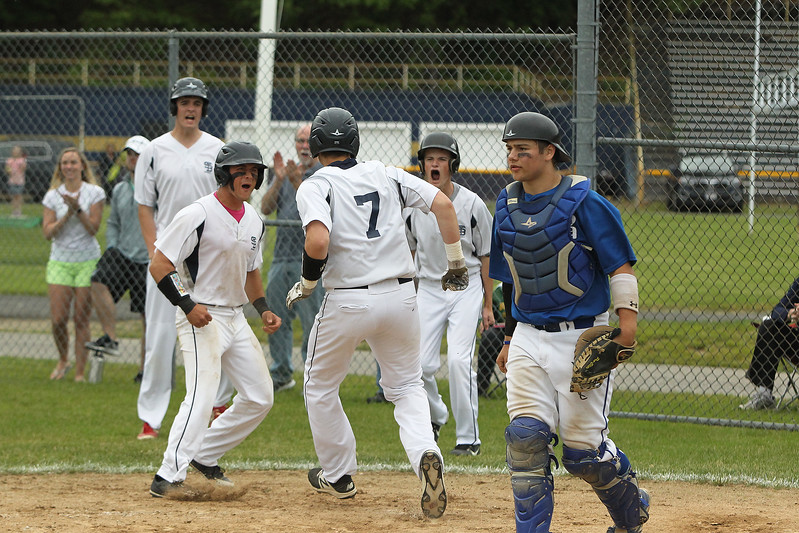 Photo Scott LaPrade - the 3 players that were on base celebrate the 3 run triple by Chris Sullivan. St. Bernard's defeated Bromfield, 3-2, in the Central Mass. Division 4 quarterfinals in Fitchburg on Sunday, June 4, 2017.