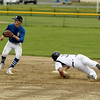 Photo Scott LaPrade - Jim Xarras looses his footing sliding into 2nd base and is called out