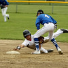 Photo Scott LaPrade - After loosing his footing and missing 2nd base Jim Xarras attempts 2nd try to touching 2nd base