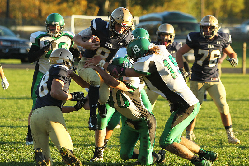 St. Bernard's Parker Bigelow carries the ball during a 21-13 win over Sutton in Fitchburg on Sunday, Oct. 23, 2016. SENTINEL & ENTERPRISE / SCOTT LAPRADE