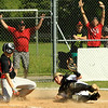 St B's catcher Connor Wironen gets the tag at home plate as Uxbridge players attempts to score