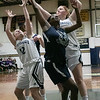 St. Bernard's Central Catholic High School girls basketball Lowell Catholic High School Friday, Feb. 7, 2020 in Fitchburg. LCHS's #24 Antonia Mukiibi reaches for a rebound with St.s B's #12 Kaitlyn Boissoneau and #24 Rhiannon Young. SENTINEL & ENTERPRISE/JOHN LOVE