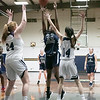 St. Bernard's Central Catholic High School girls basketball Lowell Catholic High School Friday, Feb. 7, 2020 in Fitchburg. LCHS's #24 Antonia Mukiibi puts up a shot over St. B's #24 Rhiannon Young and #14 Victoria Loiselle.  SENTINEL & ENTERPRISE/JOHN LOVE