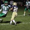 St. Bernards Central Catholic High School football hosted Sutton/Douglas High School on Friday night, Nov. 1, 2019 in Fitchburg. St. B's #26 Kaleb Lugo avoids Sutton's #13 Jonathan Altemus. SENTINEL & ENTERPRISE/JOHN LOVE