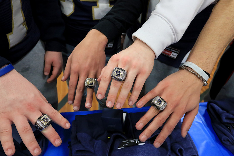 St. Bernard's basketball played Hudson High School on Thursday night, February 14, 2019. The players on the football team got championship rings and jackets after the game. St. B's juniors and football players, from left, Ben Goolsby, Liam Hale, Jaxson Poirier and Walter Morales show their new championship rings. SENTINEL & ENTERPRISE/JOHN LOVE