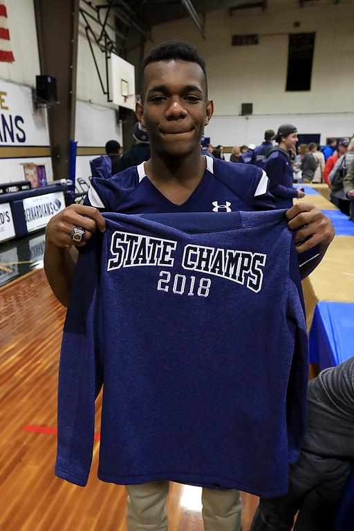 . St. Bernard\'s basketball played Hudson High School on Thursday night, February 14, 2019. The players on the football team got championship rings and jackets after the game. St. B\'s senior jaki Alexandre shows off his new jacket while wearing his new ring. SENTINEL & ENTERPRISE/JOHN LOVE