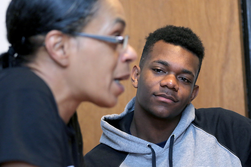 . Jakai Alexandre, 17, and his mom Heidi Beaulac at their home in Fitchburg on Friday, April 19, 2019. Alexandre listens to his mom tell their story as they sit in their kitchen. SENTINEL & ENTERPRISE/JOHN LOVE
