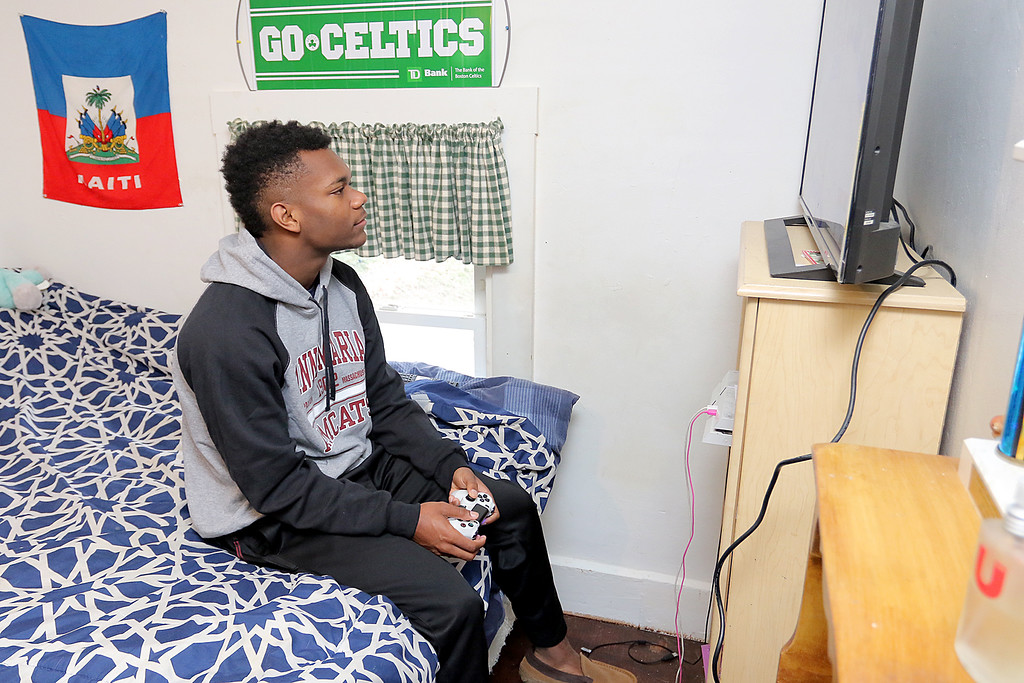 . Jakai Alexandre, 17, and his mom Heidi Beaulac at their home in Fitchburg on Friday, April 19, 2019. Alexandre likes to play a basketball video game called NBA 2K when he is not playing at St. Bernard\'s or with his friends in the local parks near his house. SENTINEL & ENTERPRISE/JOHN LOVE