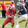St. Beernard's football played Tyngsboro on Friday night in Fitchburg. ST. B's #8 Wyatt Bingham makes an interseption during the game. Trying to stop him is THS's #9 Justin Huberty. To the right is St. B's #20 Nicolas Mancini. SENTINEL & ENTERPRISE/JOHN LOVE