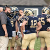 St. Beernard's football played Tyngsboro on Friday night in Fitchburg. St. B's Head Coach Tom Bingham talks to his players during a time out. SENTINEL & ENTERPRISE/JOHN LOVE