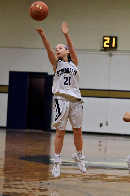 . St. Peter-Marian High School girls basketball played St. Bernard�s High School in Fitchburg on Thursday afternoon. St. B\'s Kaitlyn Boissoneau puts up a three point shot during action in the game. SENTINEL & ENTERPRISE/JOHN LOVE