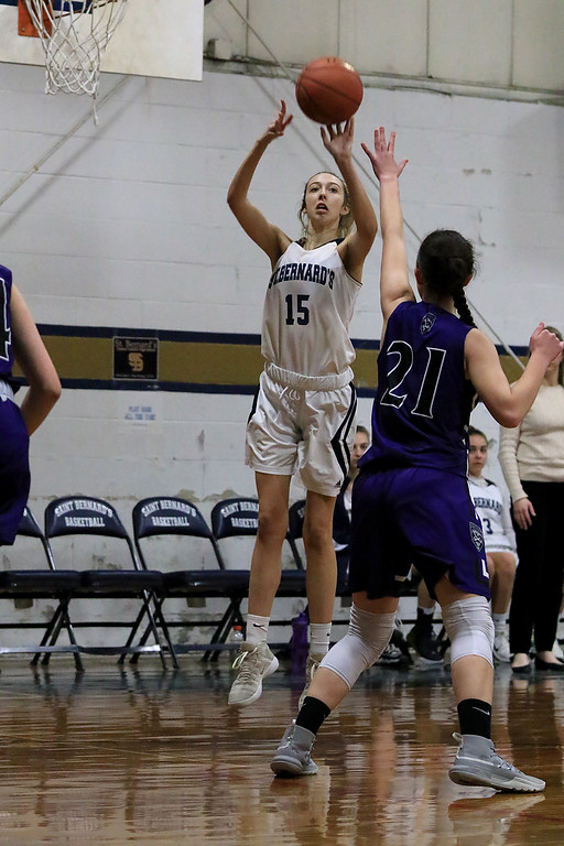 . St. Peter-Marian High School girls basketball played St. Bernard�s High School in Fitchburg on Thursday afternoon. St. B\'s Sabrina Patton puts up a three point shot while being covered by St. Peter-Marian\'s Shelby Wessell. SENTINEL & ENTERPRISE/JOHN LOVE
