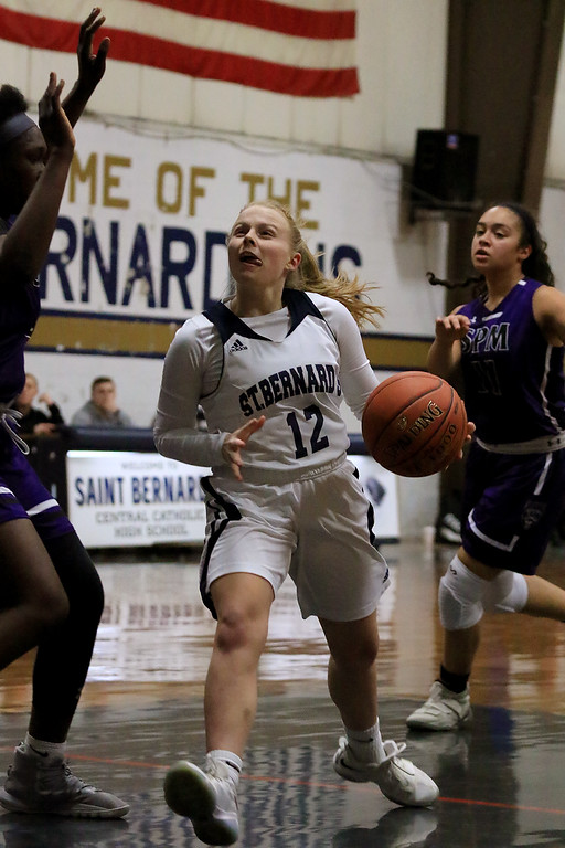 . St. Peter-Marian High School girls basketball played St. Bernard�s High School in Fitchburg on Thursday afternoon. St. B\'s Hadleigh Bigelow takes the ball to the hoop. SENTINEL & ENTERPRISE/JOHN LOVE