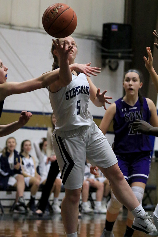. St. Peter-Marian High School girls basketball played St. Bernard�s High School in Fitchburg on Thursday afternoon. St. B\'s Lisbeth Hoyt tries to put up a shoot during action in the game. SENTINEL & ENTERPRISE/JOHN LOVE