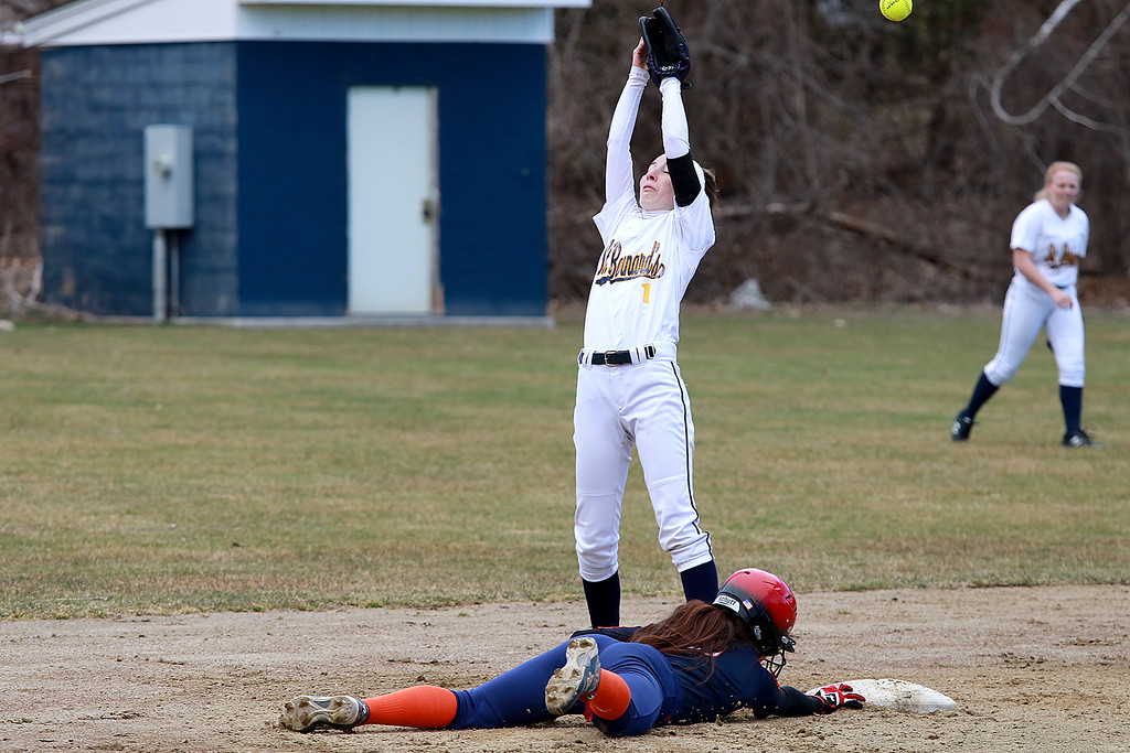 . St. Bernard\'s High School softball played Advanced Math And Science Academy Charter School in Fitchburg Thursday, April 11, 2019. AMSA\'s Erin Dean dives back to second base as the throw was high to St. B\'s Emily Malone during the game. SENTINEL & ENTERPRISE/JOHN LOVE