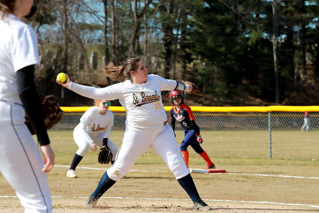 . St. Bernard\'s High School softball played Advanced Math And Science Academy Charter School in Fitchburg Thursday, April 11, 2019. St. B\'s pitcher Rebecca Thibaudeau winds up to deliver a pitch during action in the game. SENTINEL & ENTERPRISE/JOHN LOVE