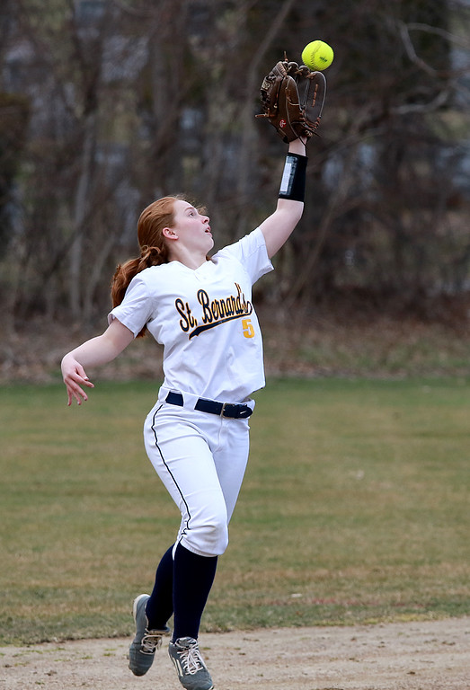 . St. Bernard\'s High School softball played Advanced Math And Science Academy Charter School in Fitchburg Thursday, April 11, 2019. St. B\'s shortstop Lissa Hoyt leaps to get a line drive during action in the game. SENTINEL & ENTERPRISE/JOHN LOVE