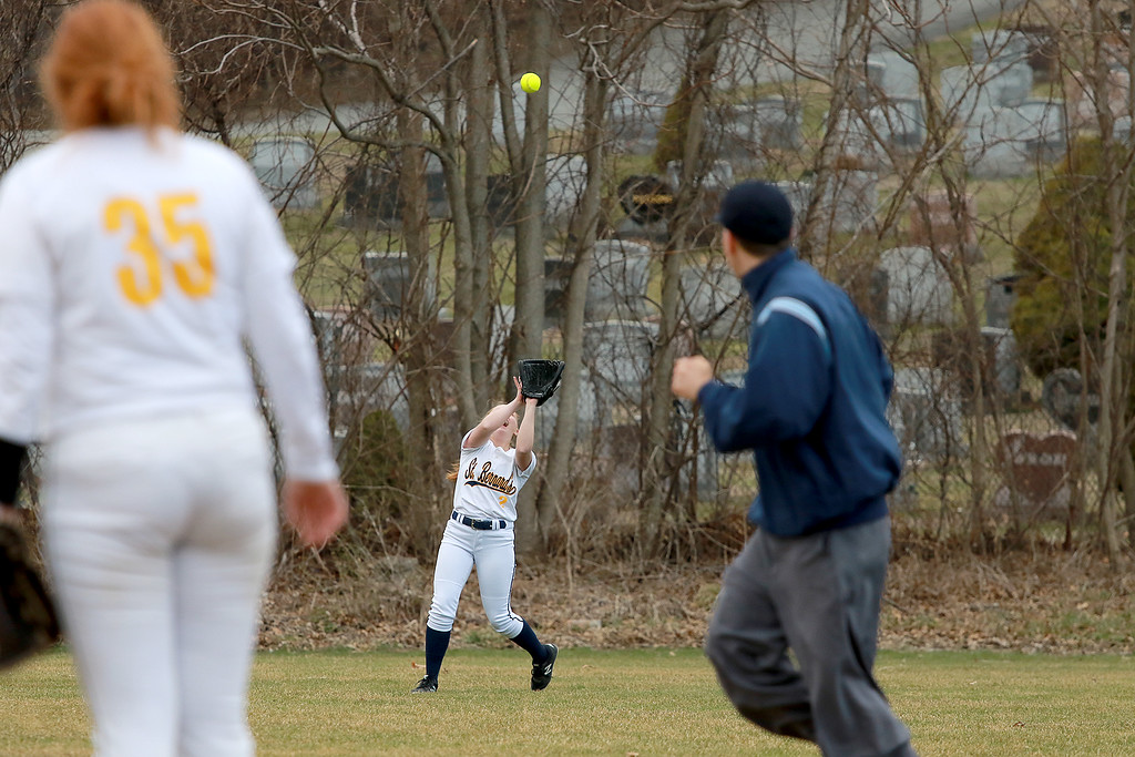 . St. Bernard\'s High School softball played Advanced Math And Science Academy Charter School in Fitchburg Thursday, April 11, 2019. St. B\'s outfielder Hadliegh Bigelow gets under a pop fly for an out during action in the game.  SENTINEL & ENTERPRISE/JOHN LOVE