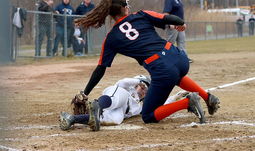 . St. Bernard\'s High School softball played Advanced Math And Science Academy Charter School in Fitchburg Thursday, April 11, 2019. AMSA\'s piper Kinney did not get the tag on St. B\'s Emily Malone as she slid into home safe. SENTINEL & ENTERPRISE/JOHN LOVE