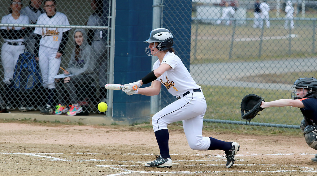 . St. Bernard\'s High School softball played Advanced Math And Science Academy Charter School in Fitchburg Thursday, April 11, 2019. St. B\'s Alyssa Thibodeau bunts during action in the game. SENTINEL & ENTERPRISE/JOHN LOVE