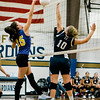 Monty Tech's Jessy Silvera and St. Bernard's Julie Foster go up at the net on Wednesday afternoon. SENTINEL & ENTERPRISE / Ashley Green