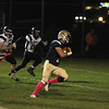 James Xarras on the run from 3 players scores a TD