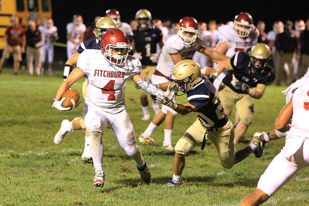 . Fitchburgs Anthony Oquendo runs with St B\'s Nicolas Mancini attempts the grab SENTINEL&ENTERPRISE/Scott LaPrade