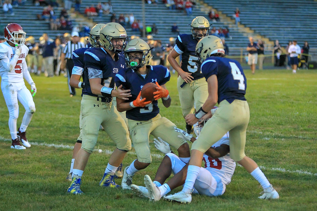 . St Bernard\'s Walter Morales Jr (3) scores his team\'s first touchdown during a 36-18 season-opening win over visiting Fitchburg on Friday, Sept. 7, 2018.  SENTINEL&ENTERPRISE/Scott LaPrade