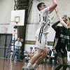 St. Bernard's Central Catholic High School boys basketball played Holy Name High School on Thursday night, Jan. 2, 2020 at ST. B's Activity Center. Putting up a shot is St. B's #30 Connor Smith. SENTINEL & ENTERPRISE/JOHN LOVE