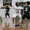 St. Bernard's Central Catholic High School boys basketball played Holy Name High School on Thursday night, Jan. 2, 2020 at ST. B's Activity Center. St. B's #12 Damien Jones covers HN's #5 Jack McGrath. SENTINEL & ENTERPRISE/JOHN LOVE