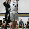 St. Bernard's Central Catholic High School boys basketball played Holy Name High School on Thursday night, Jan. 2, 2020 at ST. B's Activity Center. St. B's #21 Patrick Ginnity gets the ball blocked by HN's #15 Jaden Abilhomme as he tries to take a shot. SENTINEL & ENTERPRISE/JOHN LOVE