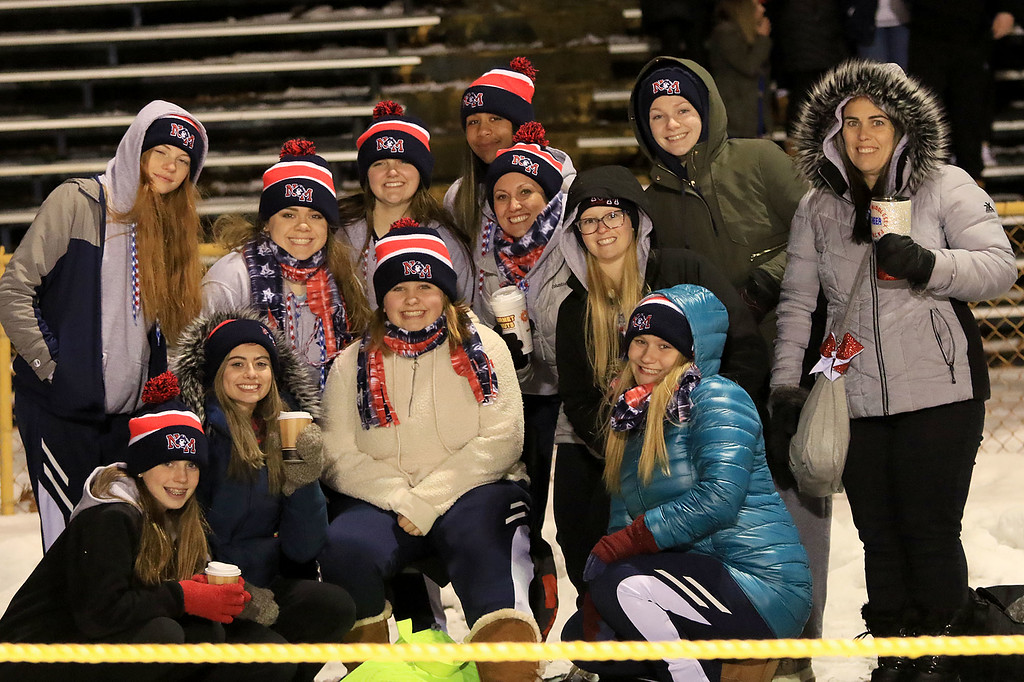 . North Middlesex Regional High School visited the Fitchburg on Wednesday night, November 21, 2018 to play St. Bernard\'s Central Catholic High School during their Thanksgiving day game. NMRHS cheerleaders posed for a picture at the beginning of the game. They dressed for the weather. SENTINEL & ENTERPRISE/JOHN LOVE